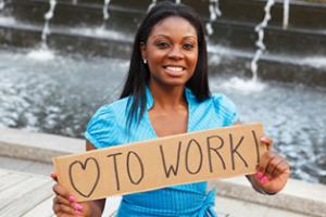"Woman with sign ""love to work"""